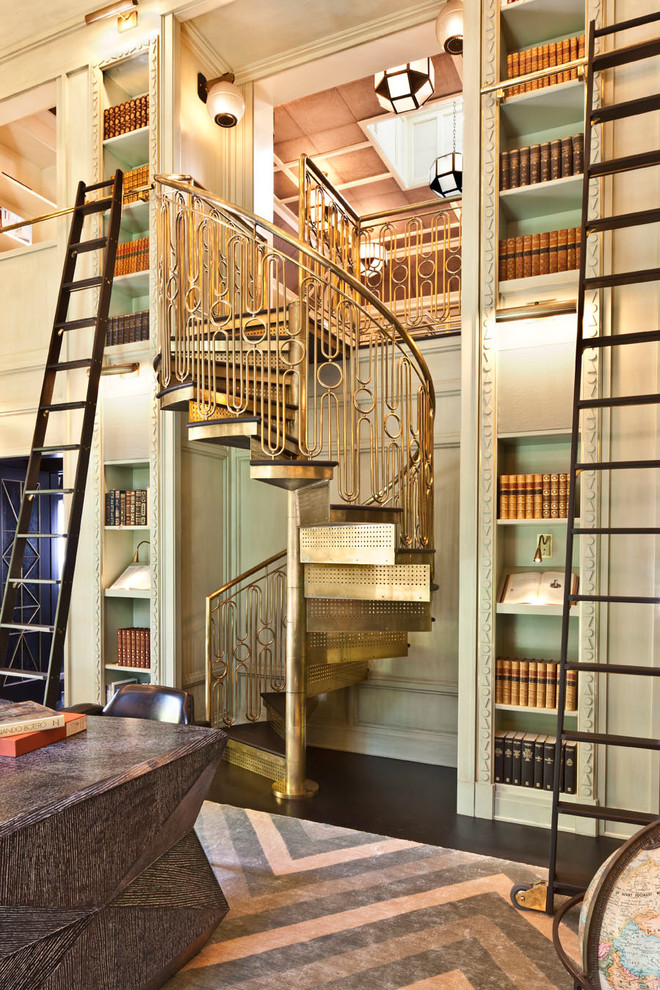 bookcase with ladder and rail gold staircase and railing patterned area rug black leathered chair antique table bookshelves