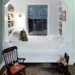 Built I Bed With White Wooden Framed, Bookshelves Inside The Space At The Ehad And Foot Of The Bed