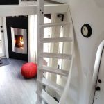 Circular White Wooden Stairs In Small Space