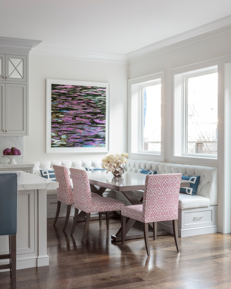 corner bench seating with storage colorful artwork wooden table pink chairs blue throw pillows glass windows wooden floor island marble backsplash