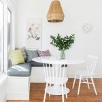 Corner Dining Set With White Round Table, White Chairs, White Corner Bench With Grey Cushioin, Rattan Hanging Lamp