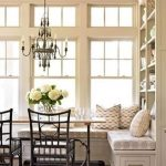 Corner Dining Set With Wooden Square Table, Black Chairs, White Corner Bench With White Flowery Patterned Cushion, Chandelier