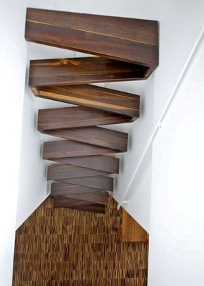 dark wooden box zigzagged stairs in small place with white wall