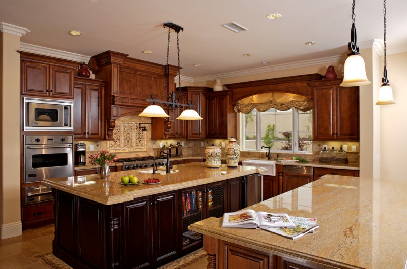 double pendant light brown cabinets brown island beige granite countertops stove beige backsplash windows sink oven