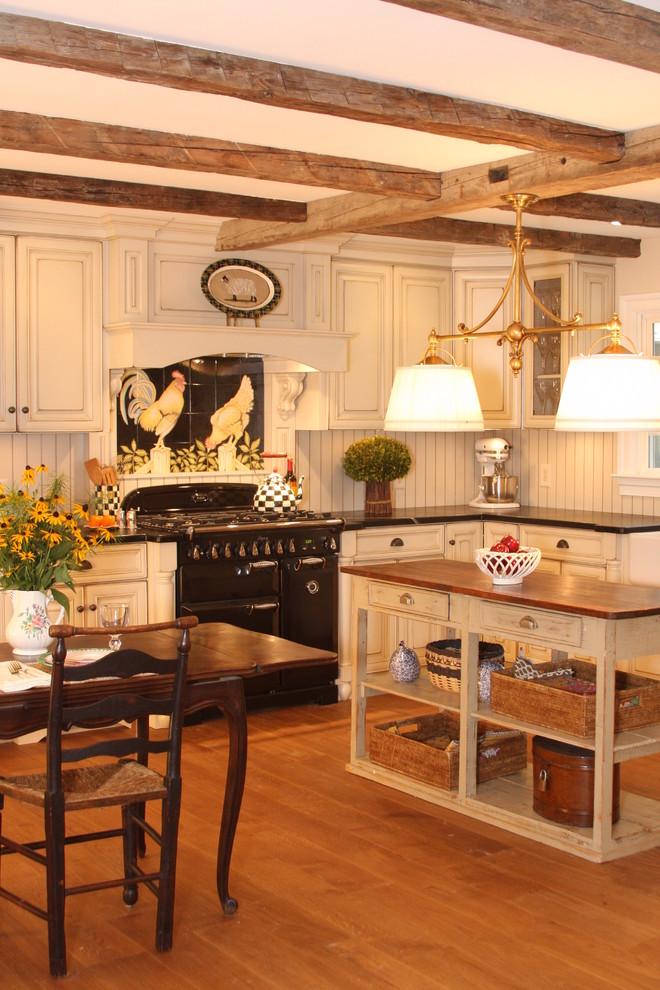 double pendant light wooden floor white cabinets black stove oven range hood backsplash rattan baskets wood beams