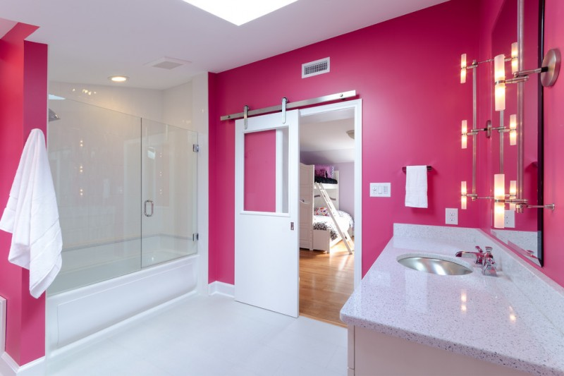 frameless hinged tub door pink walls built in tub white barh door vanity stainless steel sink mirror wall sconces white top