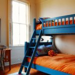 Full Over Queen Bunk Bed Blue Bunk Bed Orange Bedding White Framed Windows Table Lamp Wooden Desk Traditional Chair