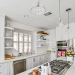 Glass Dome Pendant Light White Cabinets White Island White Countertops Stovetop Dishwasher Sink Refrigerator Oven Shelves Window
