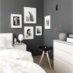 Grey Bedroom With Dark Grey Wall, Wooden Flooring, White Wooden Cabinet, White Side Table, White Bed With White Linen, White And Black Painting