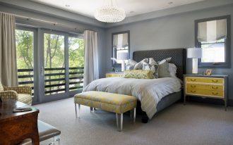 grey yellow bedroom crystal handelier nightstands table lamps window grey roman shades yellow bench armchair grey bed headboard pillows curtains