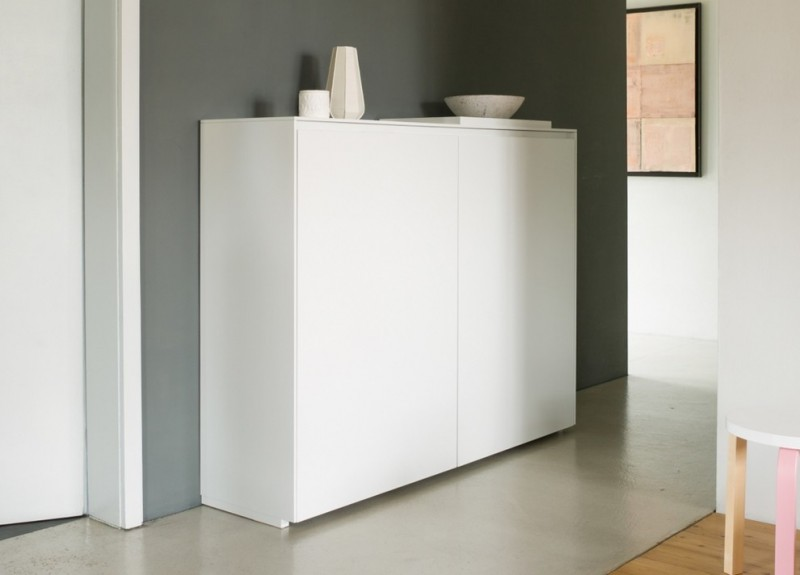 hallways with white plain sideboard, grey concrete floor, grey painted wall