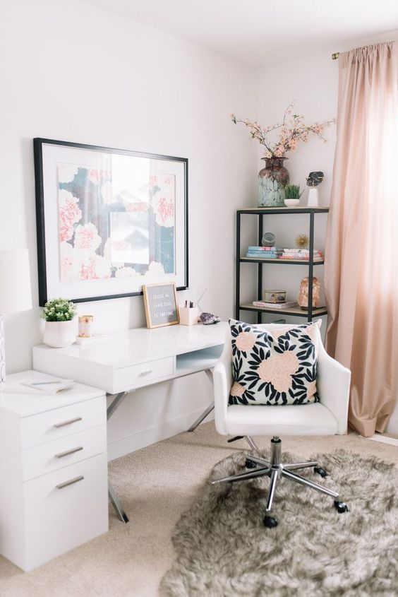 home office with nude rug, white table, white chair, black metal shelves, pink curtain