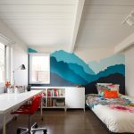 Kids Bedroom With Wooden Flooring, White Table, Red Chair, White Shelves, White Bed, Blue Painted Side Of The Wall