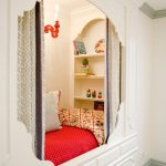 Kids Built In Bed With White Wooden Bedding, Bookshelves At The Head Of The Bed, Candle Shaped Sconces, Storage Under, Light Grey Curtain