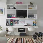 Kids Desk With Chairs Patterned Area Rug White Shelves White Eames Molded Plastic Chairs Whiteboard White Side Table