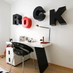 Kids Desk With Chairs Wall Letters Table Lamp Drawers Glossy Black Chair Wooden Floor White Area Rug White Walls