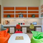 Kids Desk With Chairs White Shelves White Desk Drawers Colorful Chairs White Table Yellow And Green Bean Bags White Walls Glass Windows