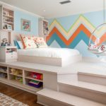 Kids Room With White Wooden Stage With Built In Bed, Side Table, And Shelves, Oval Clear Swing, Brown Wooden Floor