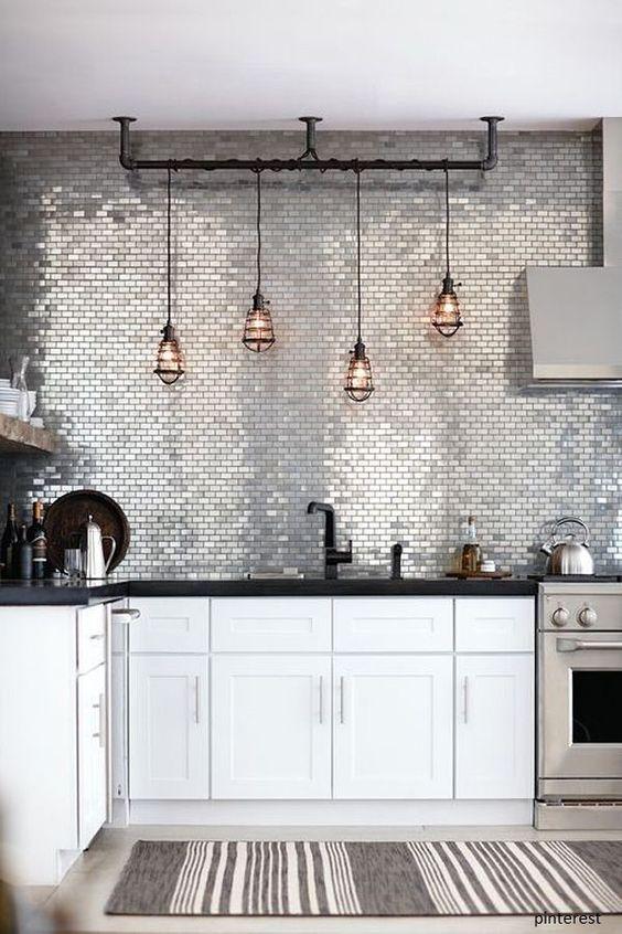 kitchen with white cabinet, black marble top, grey floor, grey shiny backsplash