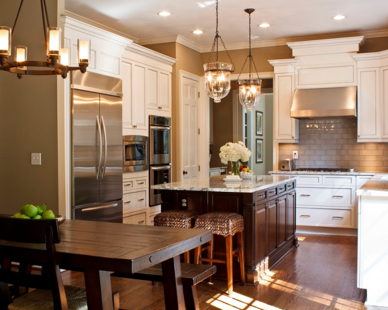 kitchen with wooden floor, brown wooden cabinet with white marble top, wooden dining set. white cabinet, glass chandeliers