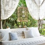 Lanai With Sofa Covered In Knitted White Blanket