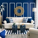 Living Room With Blue Wall, Pillows, Metallic Stool, White Sofa, Chairs, Floor Lamp, Glass Small Cabinet