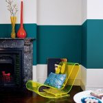 Living Room With Dark Wooden Floor, Green White Wall, Grey Stone Fireplace, Line Clear Plastic Chair