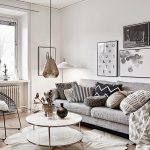 Living Room With Grey Sofa, Grey Pillows, Metallic White Round Coffee Table, Metallic Hanging Lamp, White Wall, Wooden Flooring