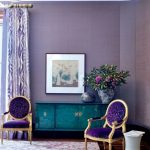 Living Room With Purple Wall, Purple Chairs, Purple Rug, Green Cabinet, Painting, Plants, White Side Table