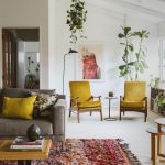 Living Room With White Floor, White Wall, Red Rug, Grey Sofa, Wooden Coffee Table, Yellow Chairs