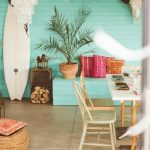 Outdoor Dining Area With Brown Floor, Turquoise Wooden Wall And Bench, Wooden Table And Chairs