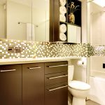 Over The Toilet Storage Mirrored Cabinet Open Shelves Mosaic Backsplash Brown Vanity Wall Mounted Faucet Sink Recessed Lighting Glass Door