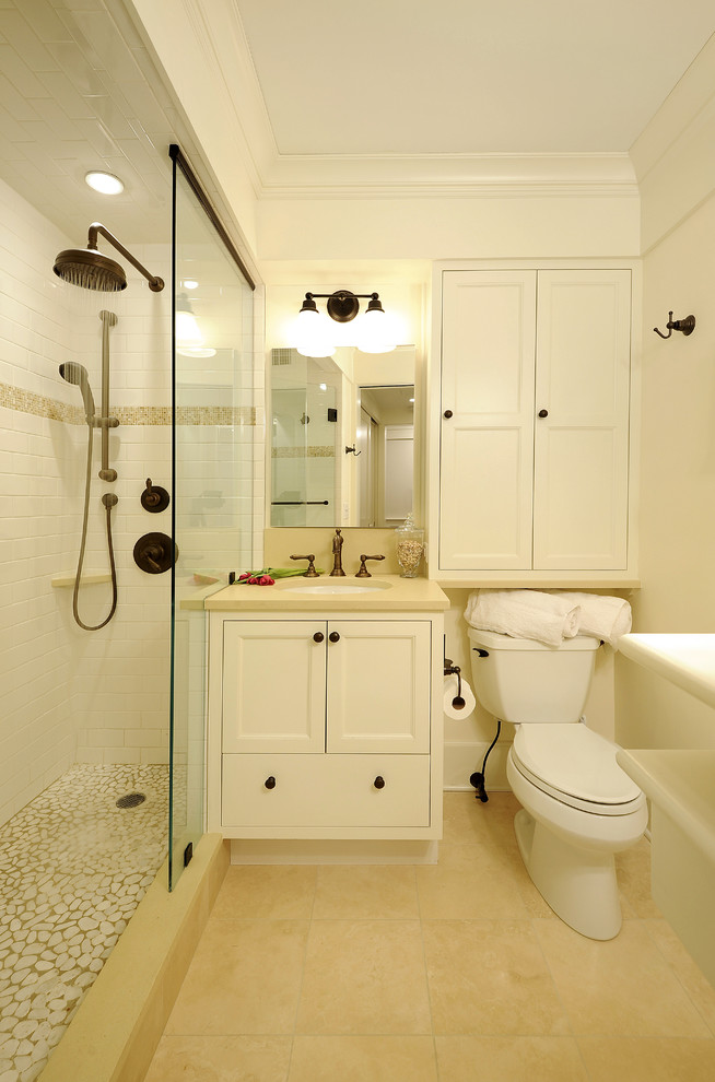 over the toilet storage wall sconce black hook white cabinet beige floor tile shower head recessed lighting mirror sink faucet
