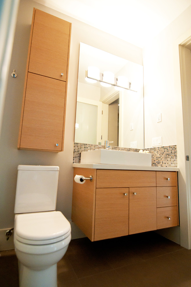 over the toilet storage wooden floating cabinet wall mounted cabinet wall sconces mosaic backsplash tile mirror