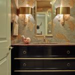 Powder Room With Golden Fish Patterned Wallpaper, Dark Wood Glossy Finished Cabinet With Marble Top, Golden Metallic Framed Mirror, Golden Metallic Wall Lamp