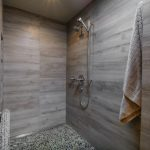 Sliding Shower Head Towel Holder Grey Wall Tiles Wooden Cabinet Recessed Lighting Towel Holder Mosaic Floor Tile