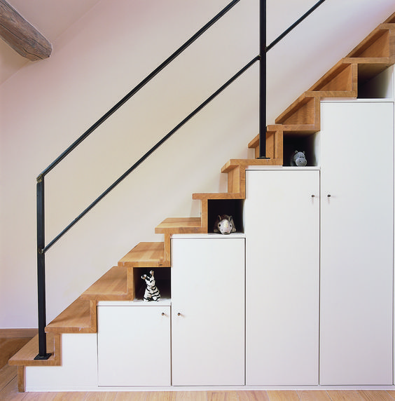 storage and cabinet and littles shelves under the stairs