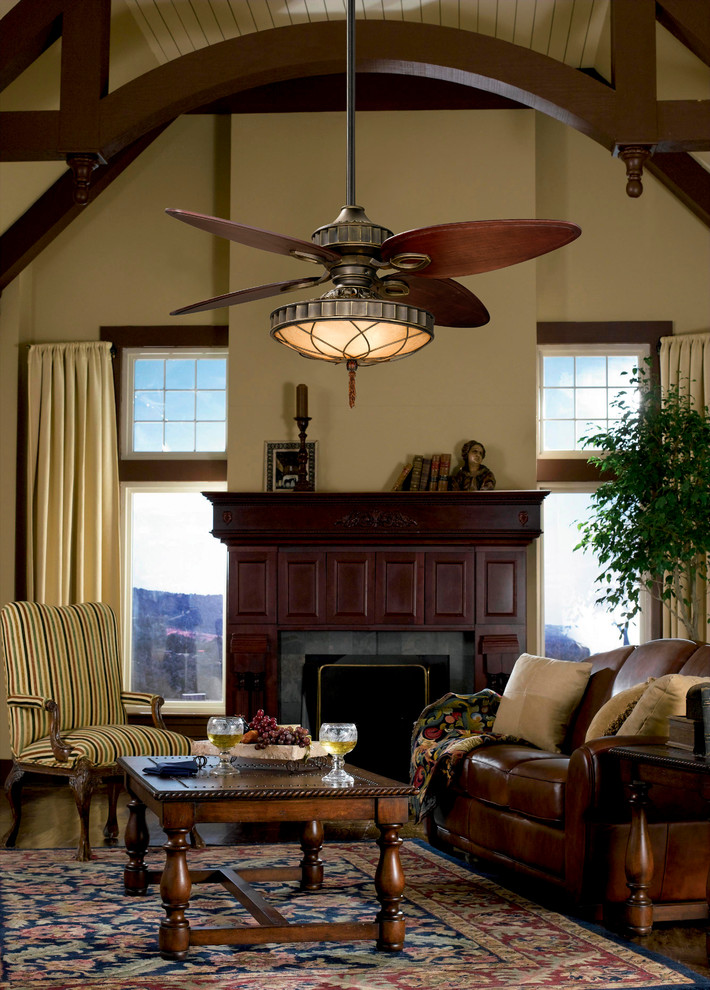 unusual ceiling fans with lamp wooden mantel fireplace brown leathered sofa stripe armchair coffee table patterned area rug windows beige walls and curtains