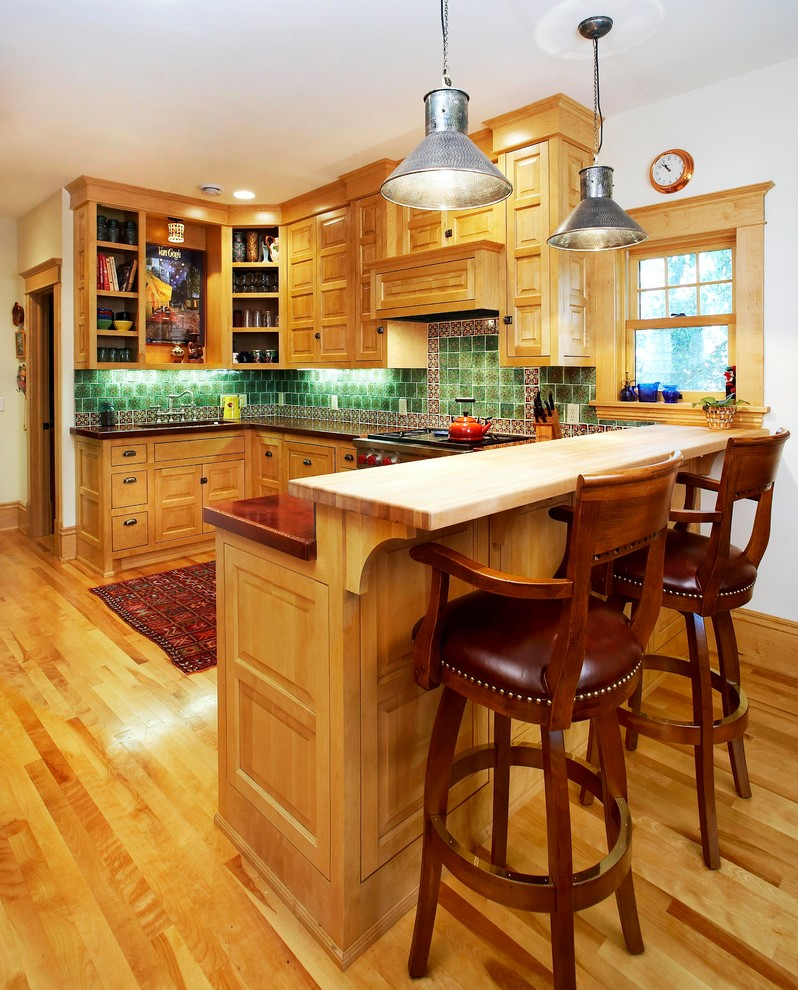 wood stool green backsplash wooden cabinets wooden island concrete countertops window industrial pendant lamps stovetop oven range hood sink shelves kitchen mat