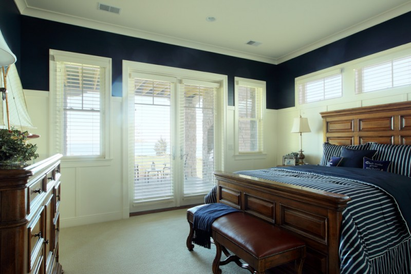 blinds for door window hard wooden bed hard wood headboard table lamp leathered wooden bench blue striped bedding white doors and windows wooden dressers
