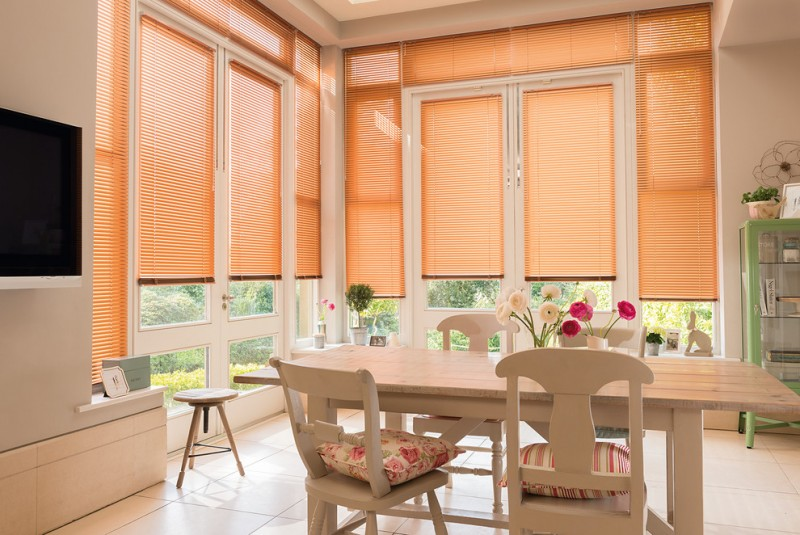 blinds for door window white framed glass windows and doors white wooden dining table white chairs glass cabinet stool