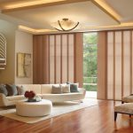 Blinds For Door Window White Sofa White Ottoman White Area Rug Wooden Floor Patterned Chairs Chandelier Recessed Lighting Staircase