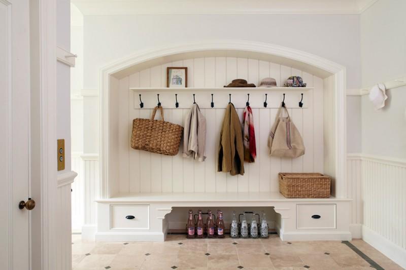 coat rack wall mount built in bench built in storage bottles rattan basket rattan bag arched mudroom black hooks