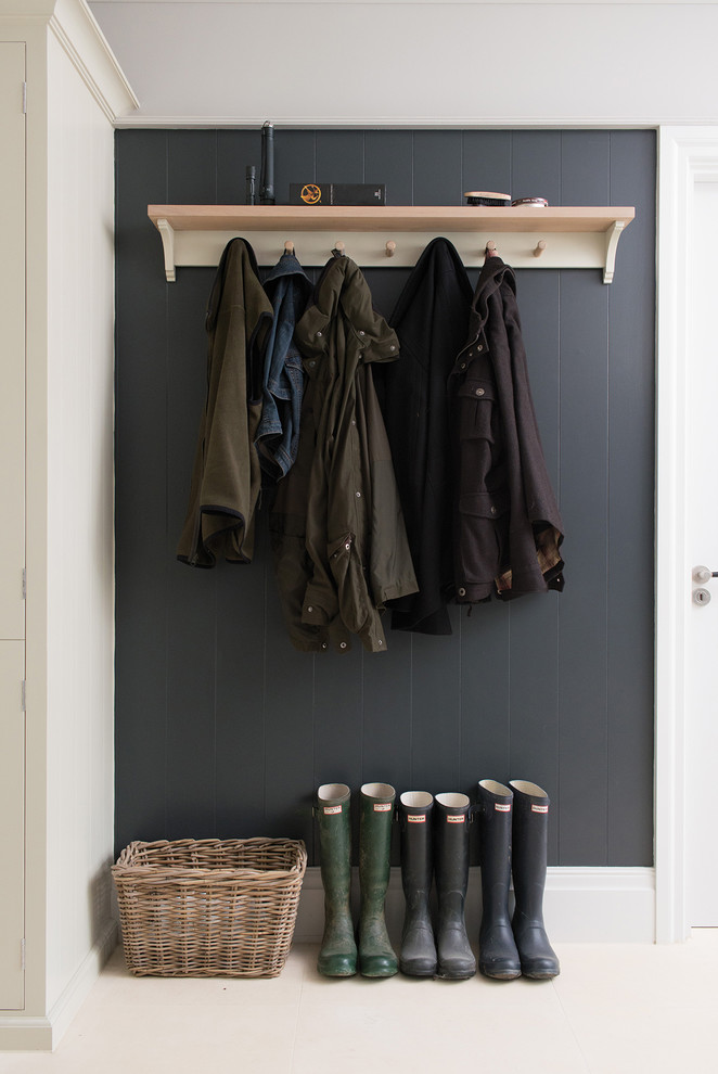 coat rack wall mount wooden shelf wooden hooks rattan basket black accent walls boots white walls white floor tiles