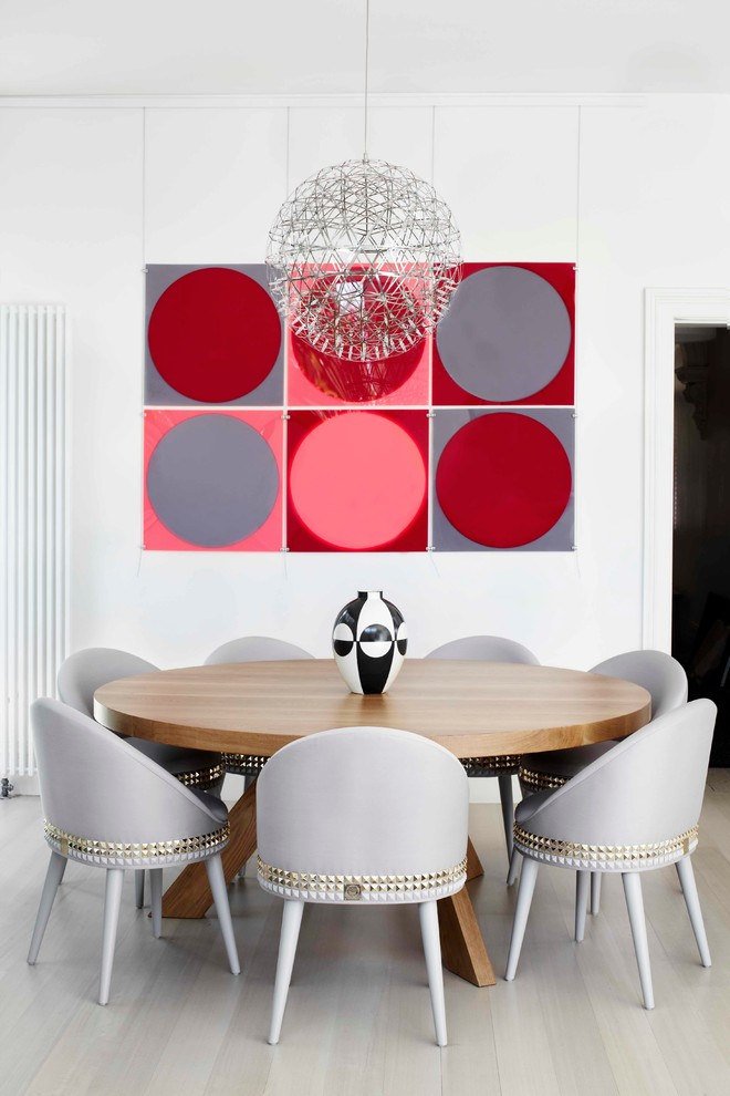 dining chair modern colorful artwork chandelier round wooden pedestal tablw decorative grey chairs white walls wooden floor