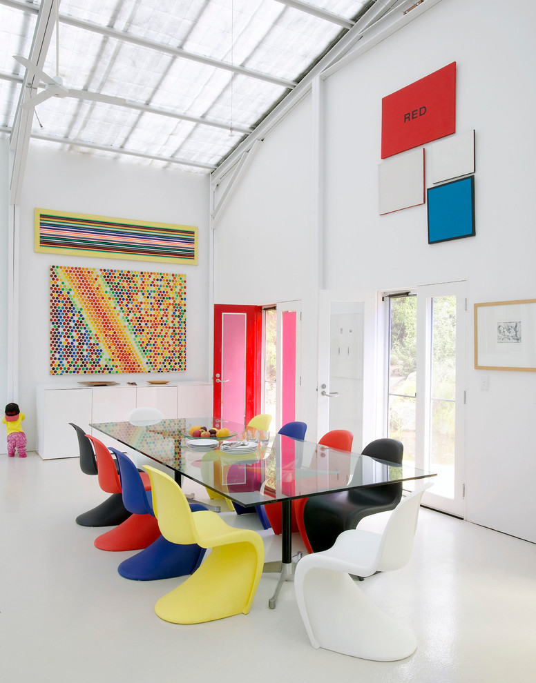 dining chair modern colorful chairs glass dining table colorful artwork white walls white floor tile glass doors