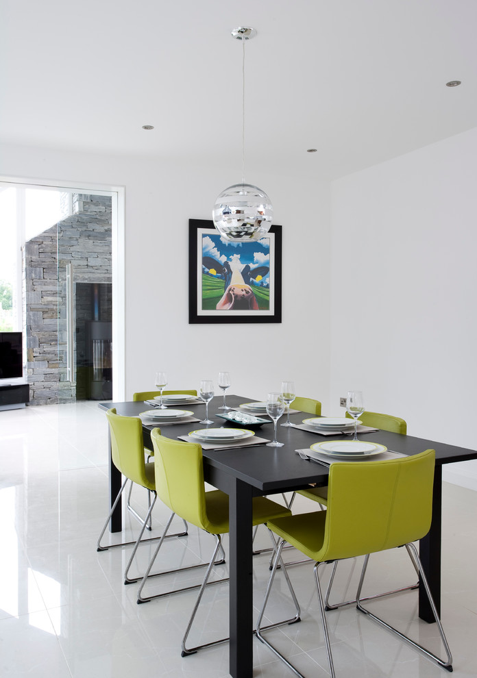 dining chair modern green chairs black dining table chrome pendant lamp white floor tile artwork white walls