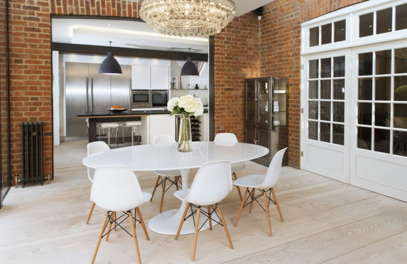 dining chair modern white eames chairs crystal chandelier white saarinen dining table wooden floor black pendant lamps glass cupboard red brick walls