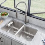 Elkay Lustertone Sink White Backsplash White Marble Countertop White Cabinet Pull Out Faucet Black Framed Glass Windows