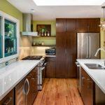 Elkay Lustertone Sink Wooden Floor White Countertop Stove Oven Range Hood Wooden Cabinets Pendant Lamps Barstools Windows Shelves